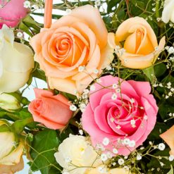 Basket of mixed colour roses