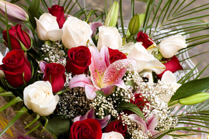 bouquet of roses and lilies with greens and floral decoration